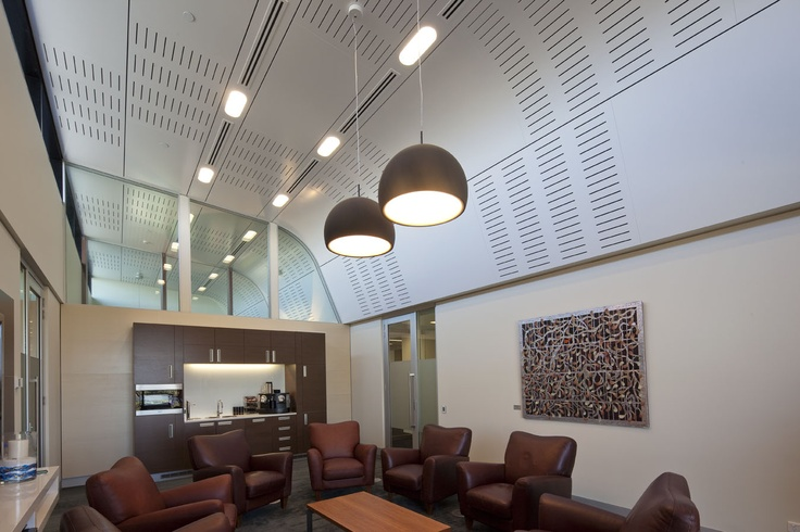 Perforated and curved ceiling panels help create a look that is simple elegant and very effective.