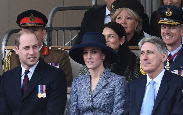 Kate Middleton Photos Photos - Britain's Prince William, Duke of Cambridge, (front row, L), Britain's Catherine, Duchess of Cambridge, (front row, centre) and British Chancellor of the Exchequer Philip Hammond (front row, R) attend a Service of Commemoration and Drumhead Service on Horse Guards Parade in central London on March 9, 2017, which honours the service and duty of both the UK Armed Forces and civilians in the Gulf region, Iraq and Afghanistan, and those who supported them back…
