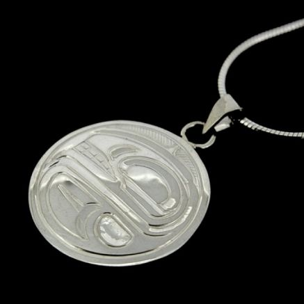 This sleek and completely unique pendant is hand-carved and measures one inch in diameter. This pendant can be engraved with the following symbols: Orca (unity), or Eagle (pride and friendship). $90. By Justin Rivard.