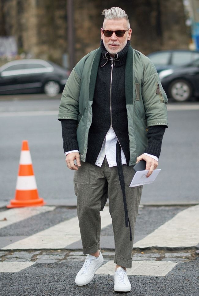 Style Icon Nick Wooster wearing a multi-layered winter style outfit on the streets of Milan during 2016.