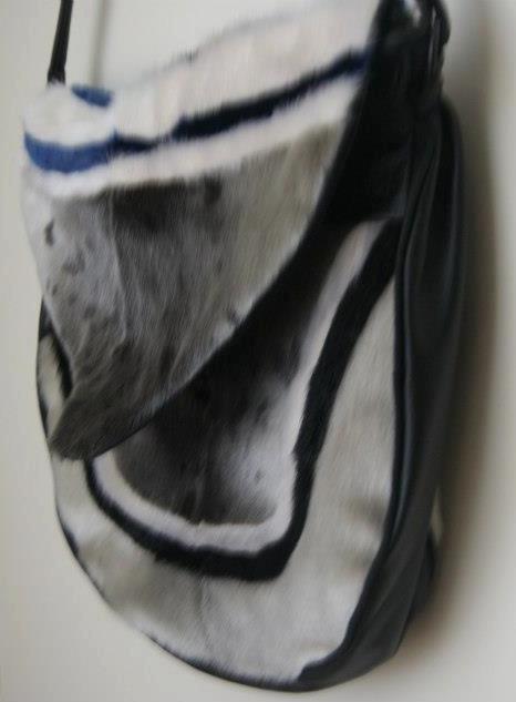 Inuit made sealskin purse amautiq style by Mary Etuangat