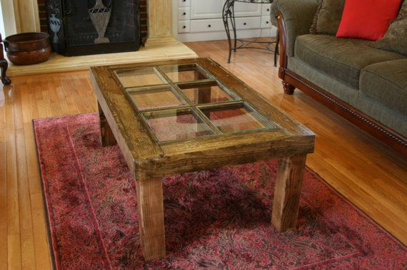 I like the legs on this window pane coffee table.  Very Rustic and chunky... simplistic design.