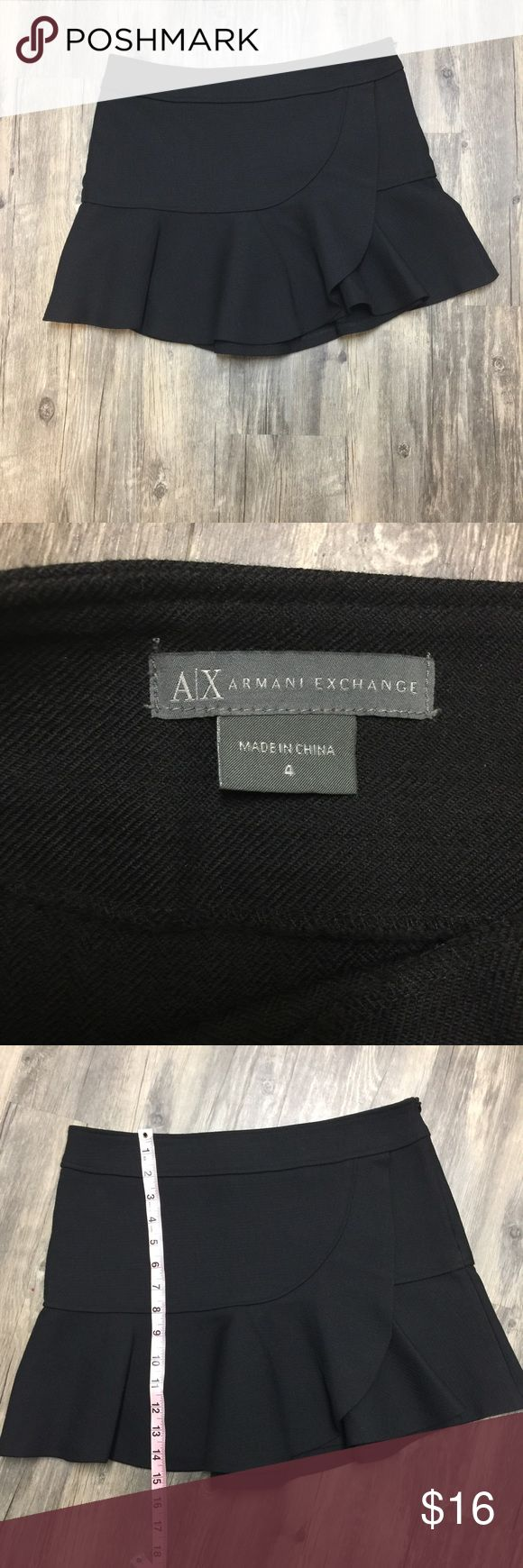 AX Armani Exchange Faux wrap skater skirt sz 4 Lovely preowned AX Armani Exchange faux wrap black skater skirt sz 4. The skirt is made of 43% wool and 42% Polyester This trendy skirt is in very good condition no holes stains rips or tear. A/X Armani Exchange Skirts Mini