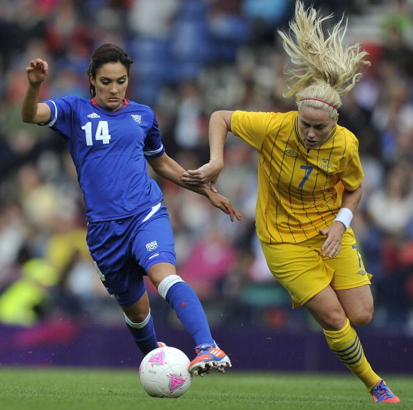 GLASGOW, UNITED KINGDOM - AUGUST 3: Louisa Necib of France and Lisa Dahlkvist of Sweden battle for the ball during the Women's Football Quarter Final match between Sweden and France, on Day 7 of the London 2012 Olympic Games at Hampden Park on August 3, 2012 in Glasgow, Scotland. (Photo by Francis Bompard/Getty Images)