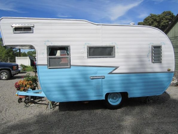 """""""Daisy"""" is all Gussied up and ready to hit the road for some fancy free glamping adventures. She's newly painted in sky blue and white, detailed with dainty daisy garlands.Repairs include, mechani..."""