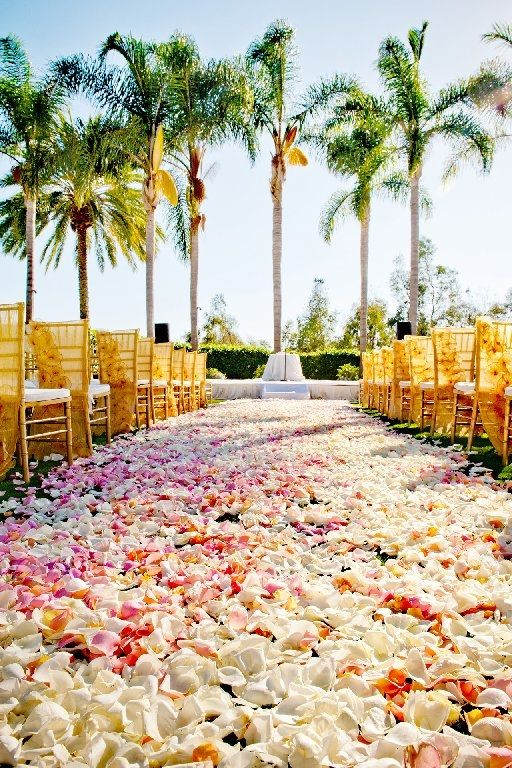 Palm Courtyard, overlooking the golf course and rolling hills of Aviara, is a magnificent San Diego wedding venue with a perfectly manicured lawn, colorful rose garden, and exquisite art sculptures.  This botanical setting blends with the beautiful scenery of the San Diego coastline. {Park Hyatt Aviara}