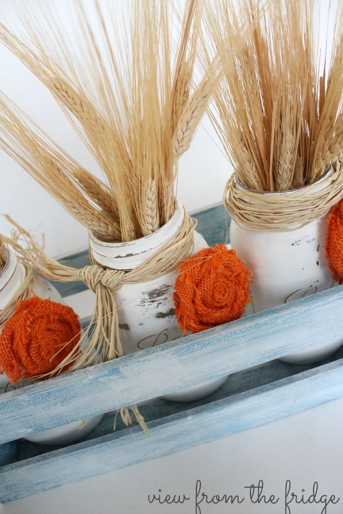 Festive Fall Centerpiece ... Distressed Mason Jars, Chalk paint, and burlap rosettes! Great tutorial from View From The Fridge for Oh My! Creative