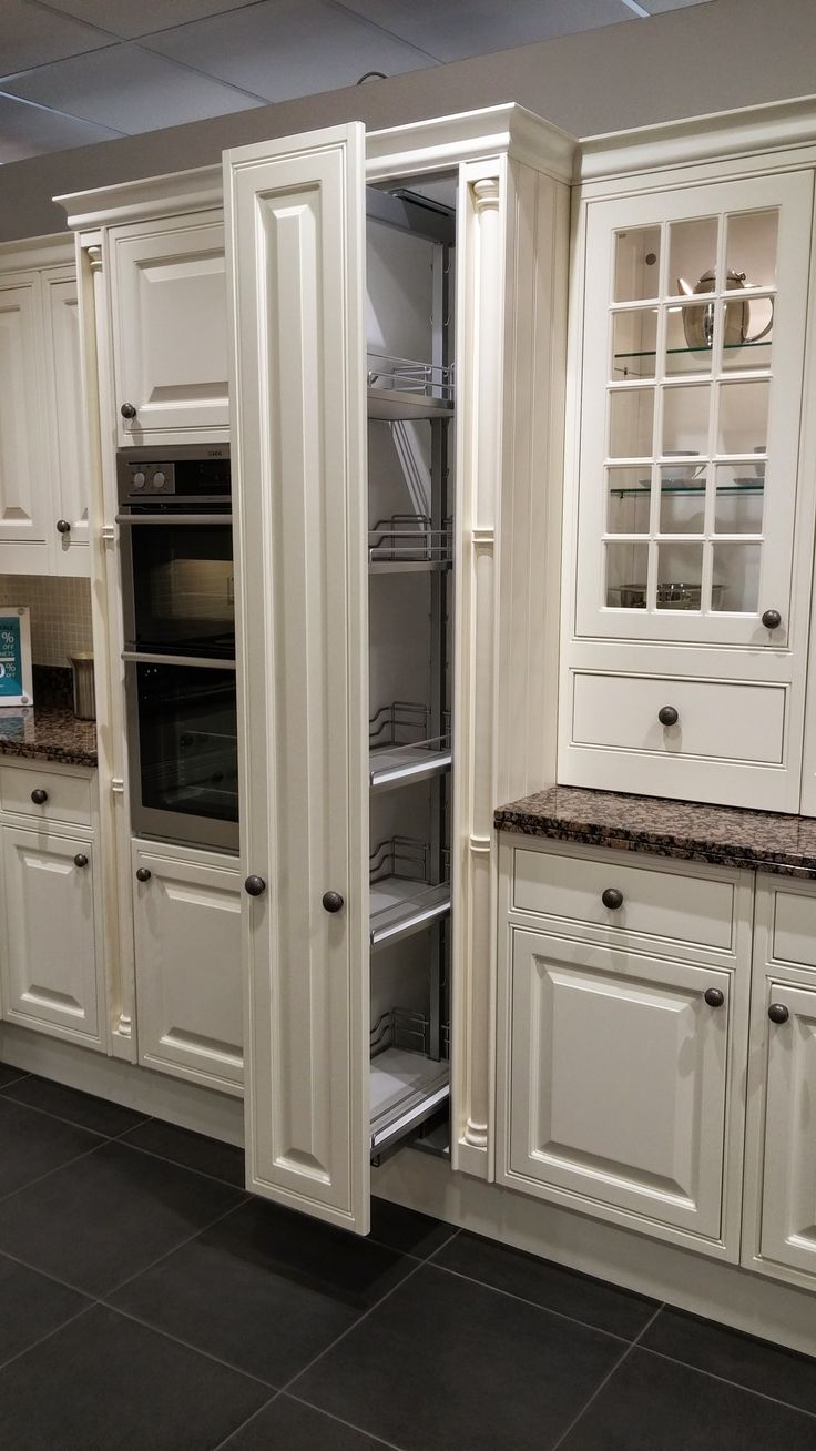 Narrow pull out larder tall thin pullout rack cupboard for Narrow kitchen cupboards