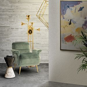 Inspired in the feminine silhouette of Brigitte Bardot, this armchair boasts modern contours, both on the slightly reclined back and on the rolled seat. It is upholstered in velvet and features tiny tapered legs in polished brass. The key shape of the slopping armrests and the horizontal tufting make this armchair an accent one for your living room.