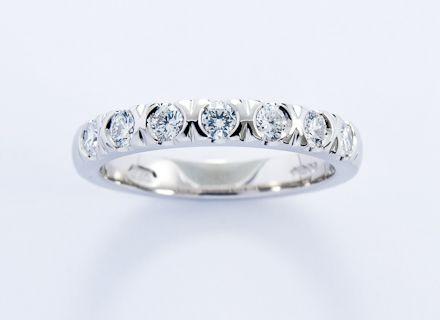 Eternity style platinum ring end set with round brilliant cut diamonds #JonDibben #diamond #eternityring