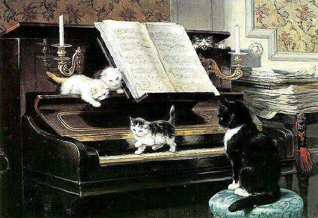 mamma gatta con gattini che giocano sul pianoforte