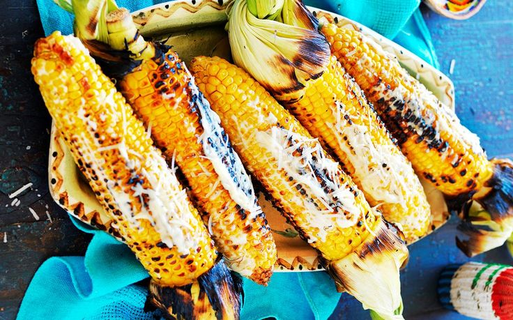 This tasty Mexican grilled corn recipe is served with chilli and cheese toppings to create the perfect starter for dinner parties or healthy snacks.