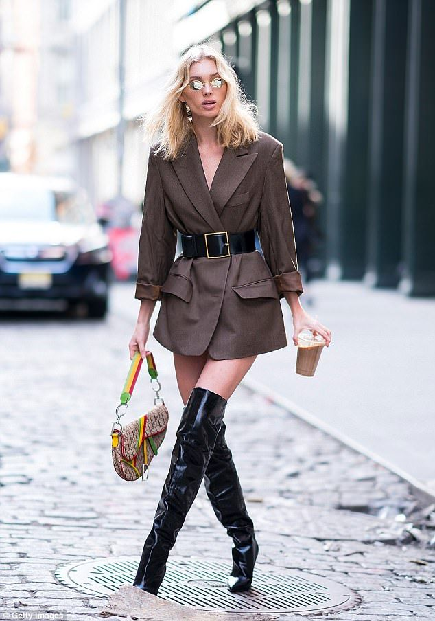 The (Victoria's Secret) Angel has landed! Elsa Hosk paraded her VERY petite figure in cinched waist blazer as she stepped out in thigh-high PVC boots, in New York City on Saturday