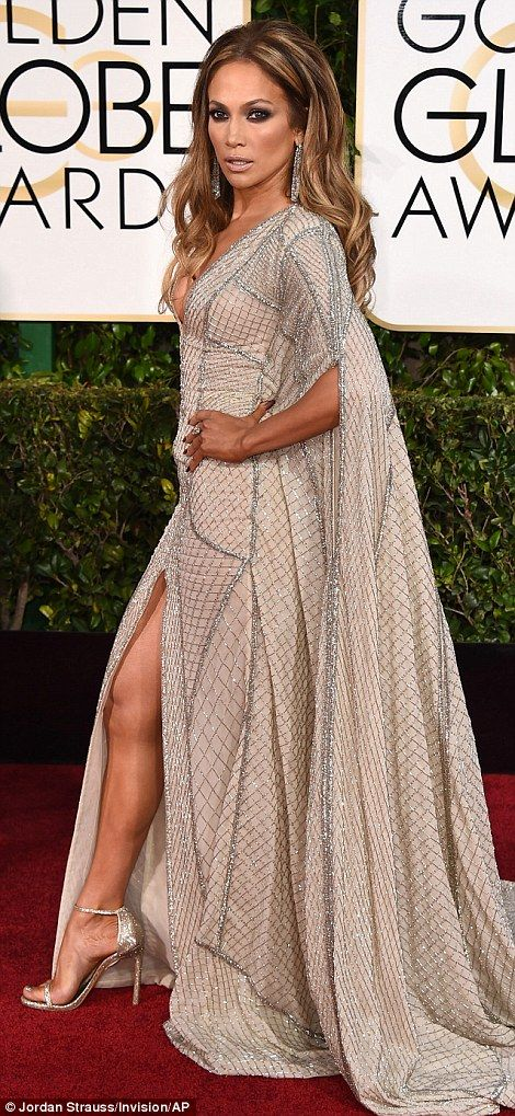 All that glitters: Jennifer Lopez made a plunging entrance in a fabulous pale caped Zuhair...