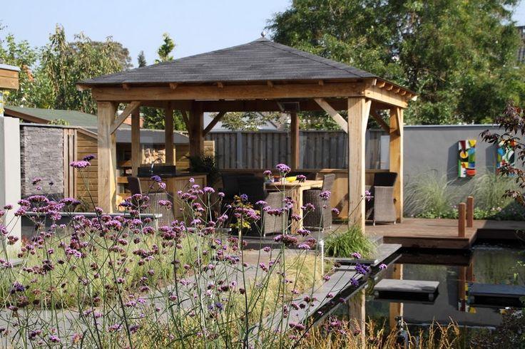 Moderne tuin met overkapping en buitenkeuken. Foto's door mij gemaakt in opdracht van De Tuinen van Appeltern van tuinen ontworpen en/of aangelegd door de Hoveniersgroep Appeltern (Exclusief geselecteerde hoveniers)