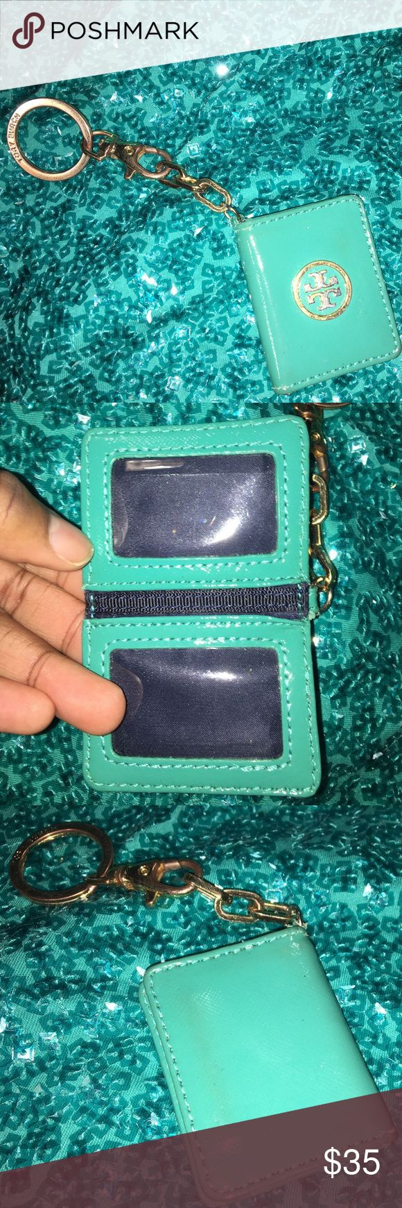 """Tory Burch Mini ID Key Chain Super cute Authentic mini-key ID holder. It shows wear from usage. Emblem has scratches and a little discolored, and little holder has a bit of discoloration. However, it's clean inside and will look great as a key chain on your handbag. Magnetic closure. Measures: 2.5""""H x 2""""W. opens to be twice the size. You can put a mini photo of your dog...or child in it!😊 Tory Burch Accessories Key & Card Holders"""