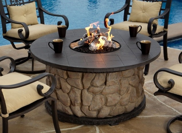 Love this gas fire pit for summer nights on our patio
