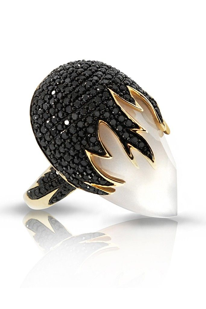 :) A yellow gold ring with black diamonds from Phillips Frankel.