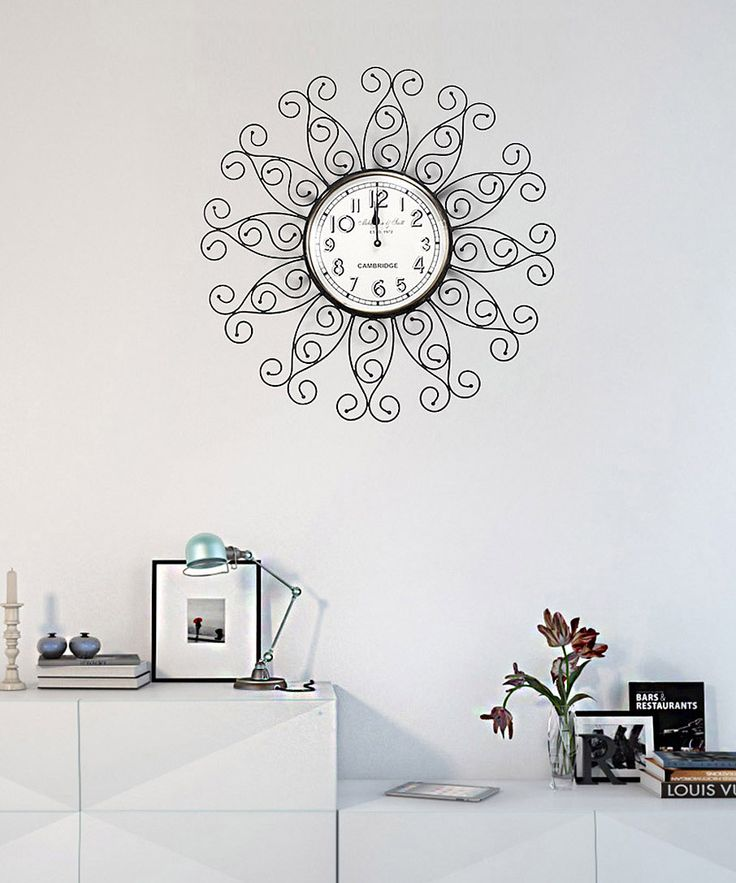 This classic wall clock is the essence of antiquated furnishings. The top and base materials are made of iron frame which wraps itself around the round shaped glass face for the lasting stay of the wall clock in your home for the years to come. Intricately carved, cast metal designs decorate the iron frame with a vintage motif elevating the grandeur of the design.