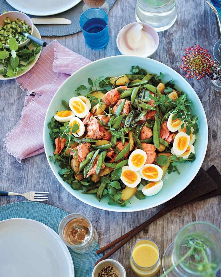 Grilled Salmon Salad | Martha Stewart Living - Grilled salmon and charred sugar snap peas give this main-course salad a smoky edge. Eight-minute eggs, watercress, and boiled new potatoes complete the hearty crowd-pleasing dish.