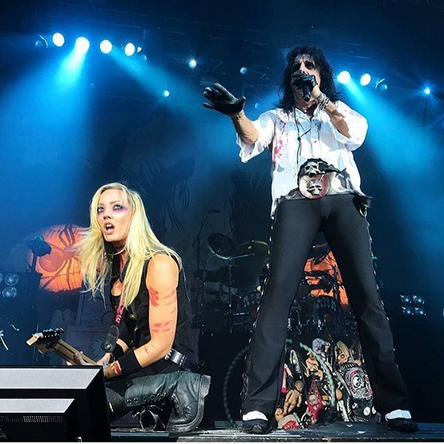 "Happy #fanphotofriday!! Thank to @murderinhighheels for this killer shot from #Oslo!! Looks like Alice is saying, ""You must be THIS TALL to ride this ride""... but I think he's actually about to say ""Some girls are like a kick in the head."" #womanofmassdistraction #alicecooper #norway #tour"