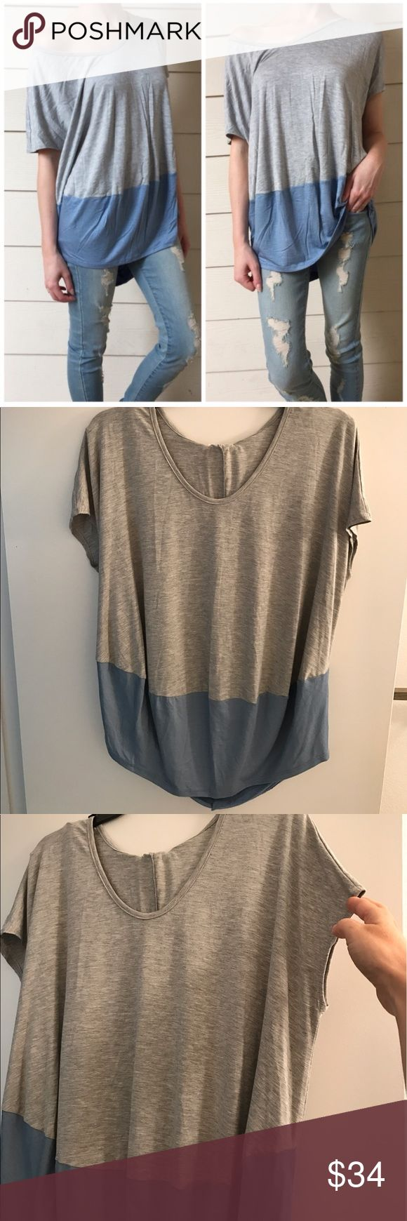 Re-posh slouchy colorblock top, NWOT. Super cute slouchy top in grey and blue. Re-posh and the first photo from the beautiful closet of @threebeez. Great top just ended up sizing up. New without tags. Size small. 23 pit, 27/30 length. Smoke free home. Tops Tees - Short Sleeve