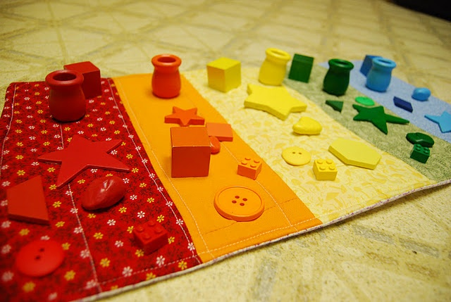 A Montessori idea. Color matching for toddler with small objects and fabric squares. Could be an easy DIY!
