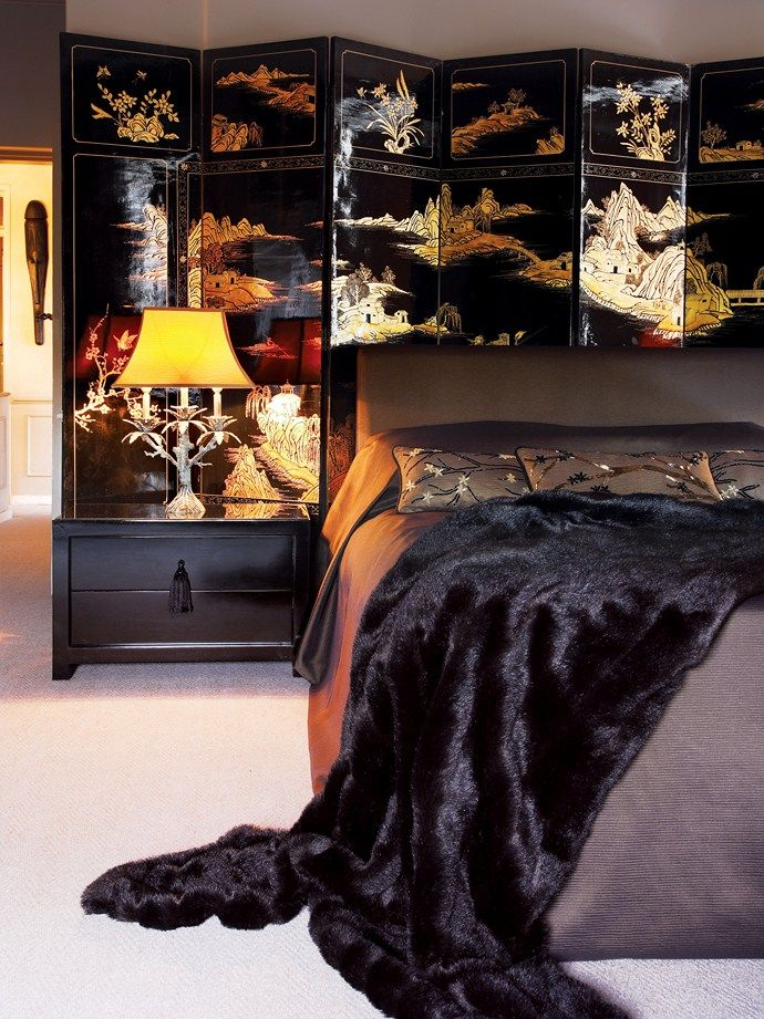 A Chinese screen introduces a dramatic note to this bedroom in fashion and decor designer Julian's apartment.