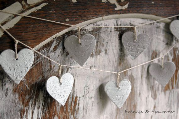 """I CAN DIY THIS!  """"Nine petite clay hearts, each one stamped on BOTH sides with gorgeous French script and attached to beautifully soft off-white linen string. Can be hung either horizontally or vertically."""""""