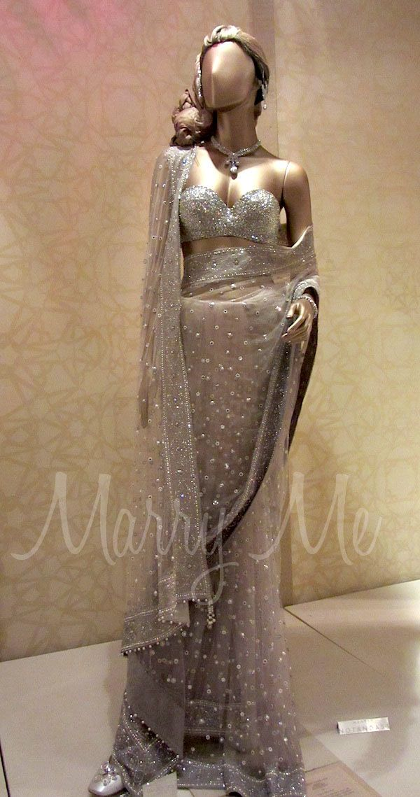 Tarun Tahiliani Bridal Couture Exposition 2011 - Swarovski Elements encrusted bustier with a tulle sari in delicate shades of grey, embellished with tiny floating flowers and a hand embroidered threadwork border.