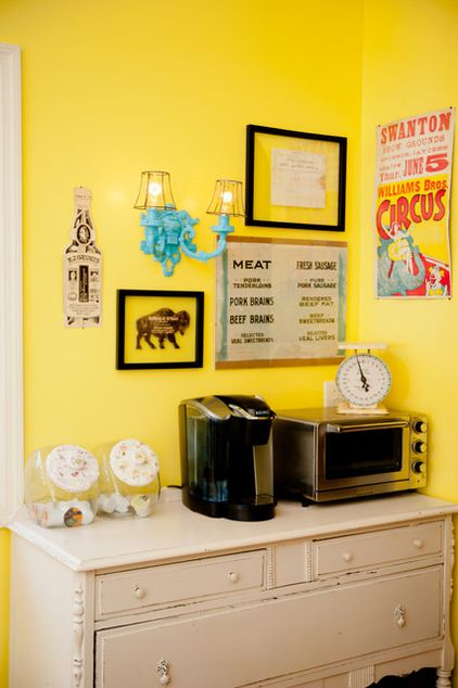 There's nothing that appealing about a modern toaster oven and coffeemaker. But even these small appliances look good when they're set atop a vintage painted sideboard and paired with framed food-oriented prints and menus.