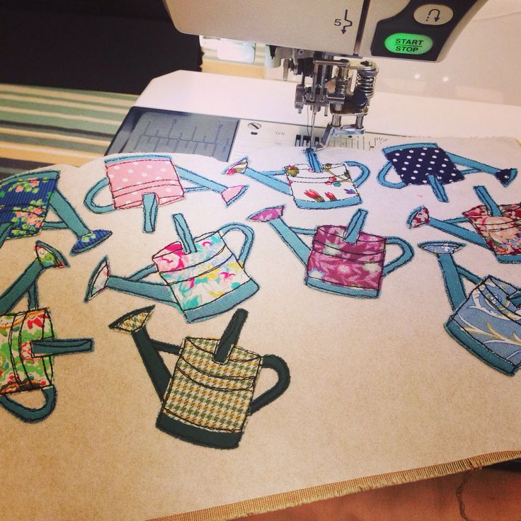 Stitching watering cans to become brooches