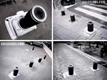 Canon advertised its S1 camera model in 2006 w/ this sticker ad on street columns. Not only does the column provide the perfect shape for the lens, but its base sticks up just enough from street level just far enough to give the camera a slightly 3-dimensional look | 12 Clever Ads on Street Poles and Pillars