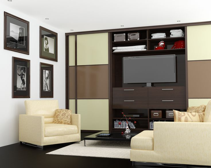 Living room wardrobe with space for TV in the middle. Design made by Urban Wardrobes.