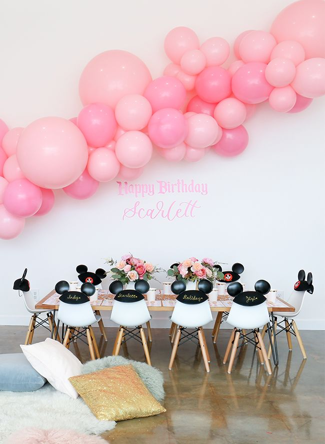 This pink vintage Disney birthday party, celebrating a girl's 3rd birthday, incorporates everything anyone obsessed with Disney princesses could dream of!