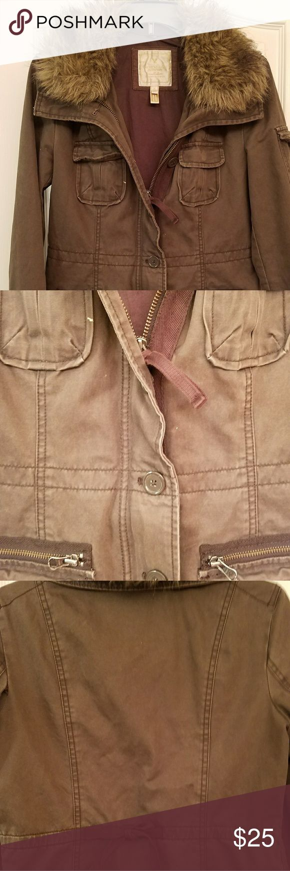 Jacket American Eagle Dark tan  naturally weathered American Eagle jacket/coat. Faux fur collar,  accent tie 2 to gather in the back, 4 front pockets and pockets on the sleeves.  Used very little in the tropics.  Smoke free home,  Make an offer! American Eagle Outfitters Jackets & Coats Utility Jackets