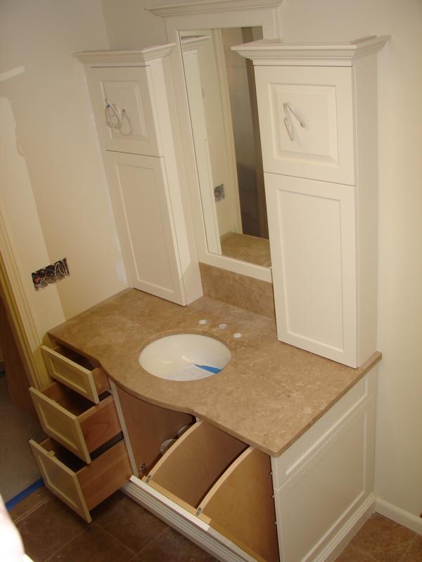 Vanity W Laundry Chute To Basement Bathroomy