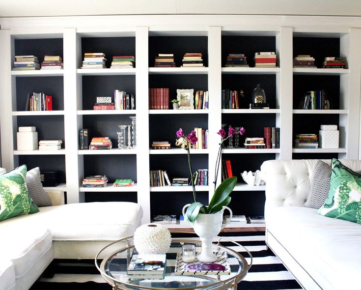 Take inexpensive bookcases from Target and turn them into built ins. Great hack and tutorial. This entire hack only cost 350 dollars! Black and white living room. Striped rug.