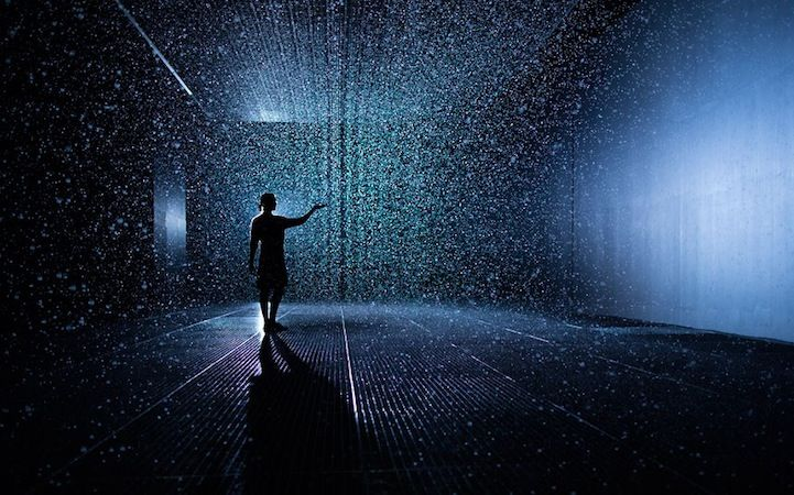 No need to bring your umbrella to this interactive installation piece. This mystical indoor rain room by Random International utilizes light, movement, and presence as the foundation of their artwork, which is why visitors can experience the soft pitter patter sound of the raindrops without even getting wet. As they walk, sensors detect motions which in result choreographs the water away from them as if the visitors control the weather.