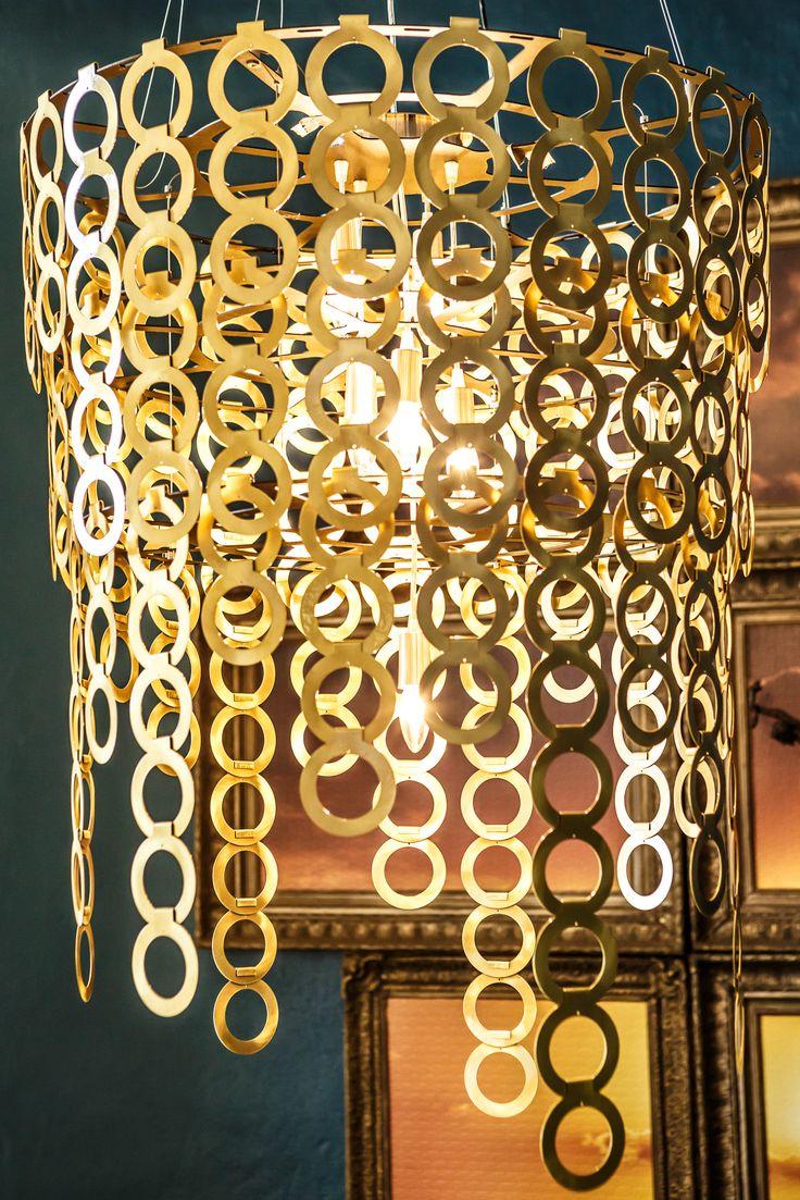 Dramatic lighting, elegant brass chandelier.
