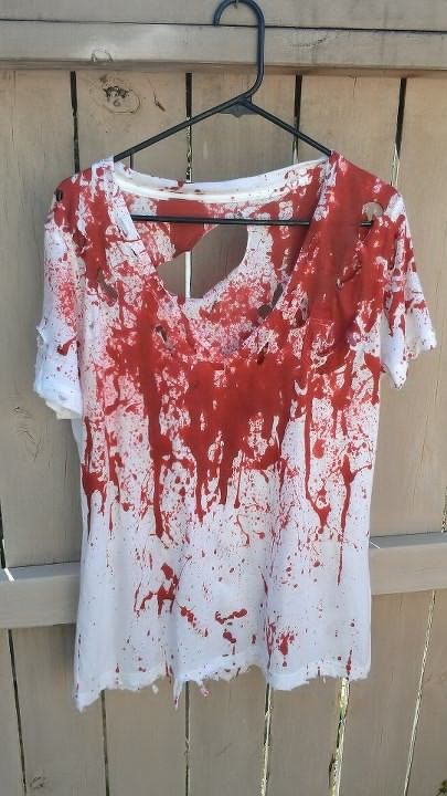 Zombie Costume by AreWeZombiesYet on Etsy, $20.00.. It's just a white t-shirt with fake blood all over it and holes.  Eeeeasy to make! ;)                                                                                                                                                                                 More