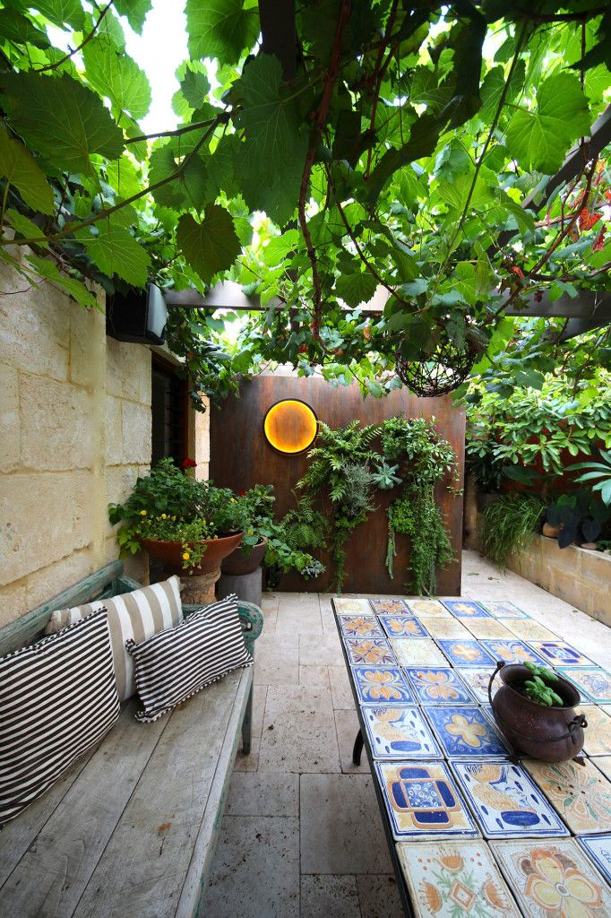 Mediterranean Small Courtyard Design & Renovation Project Scope Travertine Paving 'Miletus' French Pattern Natural Limestone cladding 35ml External paint and flooring selections and finishes Liquid Iron Instant Rust Daisy Greenwall...