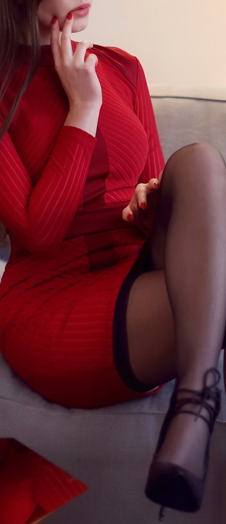 Red tight dress, stockings and lace boots on a pin