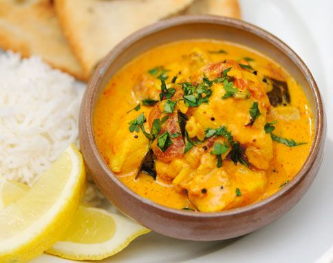 Jamie Oliver's Keralan fish curry with mustard seeds, curry leaf, garlic, ginger, shallots, turmeric, tomatoes, coconut milk -- love this flavor.  can do this with shrimp, too.