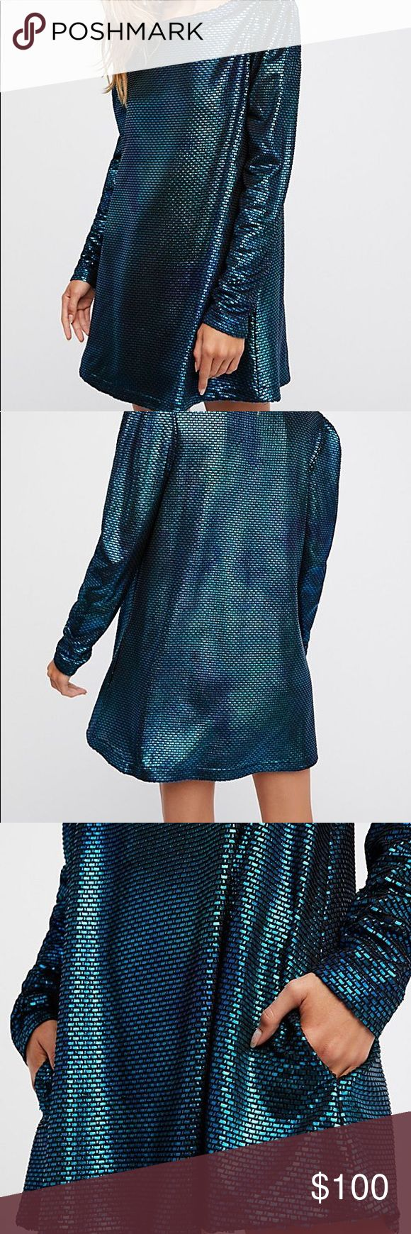 NWT Free People Diamonds are forever dress NWT Free People Diamonds are forever dress.  Long sleeve metallic mini dress featuring structured shoulders and a swingy silhouette. Side pockets! 100% polyester Never worn. **all items come from a smoke free, pet free home** Free People Dresses Mini