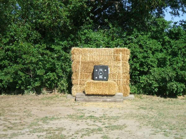 Haybales for archery targets - Must have this in the backyard :)
