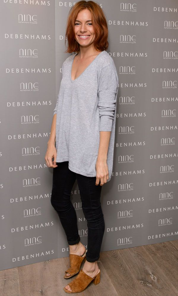 Letting her new red hair and her sister's new collection get the attention, Sienna Miller went for a laidback look at the Nine By Savannah Miller launch party in a grey top, jeans and suede sandals. Love the sandals as much as we do? We've found a pair from Zara for £49.99.