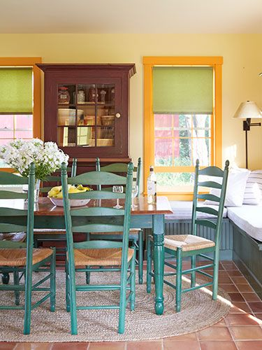 COLOR! The house boasts nine brilliant shades of paint. The dining table and chairs are from L.L. Bean.