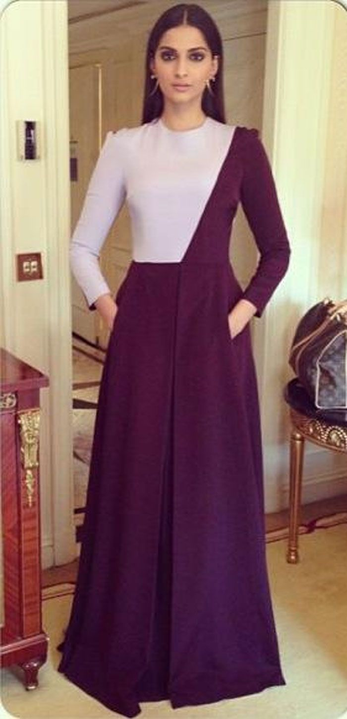 Sonam cut a fine figure in a long-sleeved, colourblocked Barbara Casasola dress with smoky eyes and hoop earrings.
