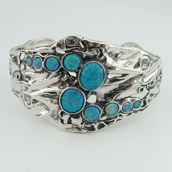 Magnificent cuff bracelet from Hadar Designers collection.  This bracelet is made of beautifully 50mm wide sculptured sterling silver and decorated